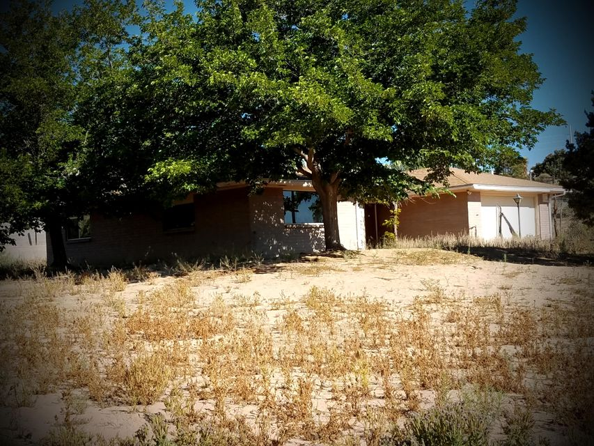 GREAT PRICE and OPPORTUNITY! . . . for an enterprising buyer willing and capable of making some repairs & upgrading this well built 2200+ sq.ft. home situated on lot that offers unobstructed mountain and city views from a great and very convenient South Corrales location. 3 Bdrms, 2 full baths, 2 living areas, oversized, finished two car garage & numerous mechanical systems upgrades. Septic tank and leech field replaced within the past year. Property has a good well, as per an inspection within the past year. If you're looking for an opportunity to experience the rewards of your sweat equity, check this home out. It will sell fast!