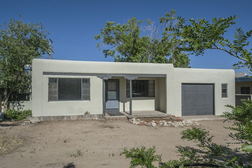 Great investment and living opportunity in very close proximity to Nob Hill, UNM, Hyder Park, Base, Hospitals, Sports Center and downtown. The home has hardwood flooring, updated custom interior doors, modern plaster and wood-slat walls, new paint inside and out, new evap. cooler, 3 bedrooms and 1.5 bathrooms included in a very functional floor-plan. Spacious, secure back yard with large shade trees, garden, and a patio for outdoor entertaining with great rooftop vistas. This well cared for property has excellent rental potential for an investor and is a great location for students, military, visiting residents, medical and other professionals that want easy access to the city's trendy urban areas.