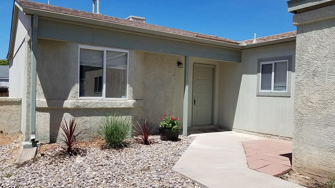 Light and bright, recently painted and newer cabinets.  This 2 bedroom has NO CARPET and sits on an extra large lot.  Peaceful and quiet, come see today!