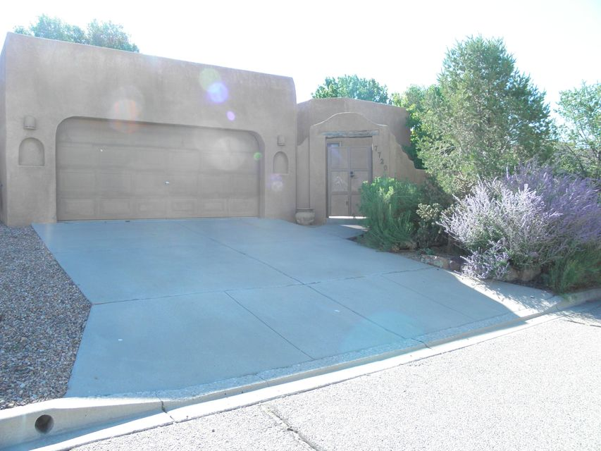 Price has dropped by $20k since first listed! In the Prestigous Sandia Heights. New TPO roof just installed, new carpet in living room, new toilet in guest bathroom, and other updates. Vigas and tongue-and-groove ceilings; nice rich floor tile; many Skylights, covered patio in back with grape vines and apple tree; nice antique stove in kitchen which conveys; a 19'x7' hobby room which is not included into the square footage; Refrigerator, Washer, and Dryer; a lot of storage shelves in the 2-car enclosed garage; interior central vacuum cleaning; and very nice gated front entrance area to front door. The Large Master Bedroom has a Double-Sink Vanity, Bathtub, Shower, and a Gas Log Fireplace as does the Living Room. This home is in ''Ready to  Move Into'' Condition!