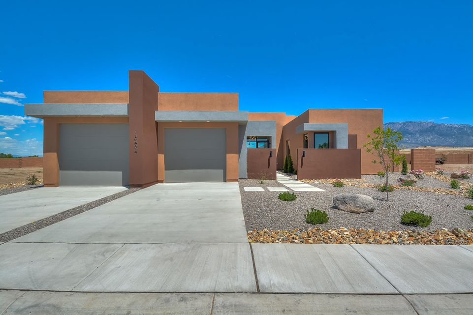 Stunning Custom built contemporary home by William Cervatnes. This home is located on a large quarter acre lot in the gated Amara Vista neighborhood. Featuring 2,444 sf w/ 3 suites all with private baths, an over sized 3 car garage and 2 sky decks! Beautiful living area with custom trayed ceiling, gas fireplace & breathtaking mountain views. Gourmet kitchen with high end cabinetry, built-in oven & microwave, gas cooktop, quartz countertops, tile backsplash & center prep island. Dining area w/ customized wet bar. Nestle into the cozy master suite by the fireplace or take in the views. Bath hosts a freestanding soaking tub, his/hers vessel sinks, walk-in shower & walk-in closet w/ shelving. 2 Junior suites. Enjoy sunsets on the amazing sky decks w/ glass railings or under the covered patio.