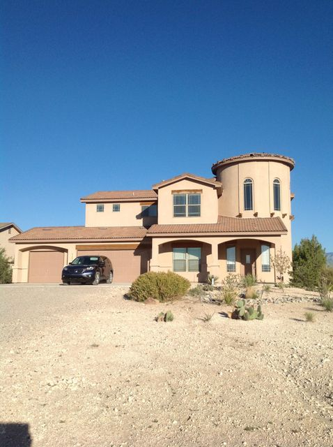 Open and bright home with loft overlooking living area. Breakfast nook, Formal dining, Kitchen island, master bathroom has double sink, separate shower, walk in closet.Half Acre With Views of Mountains Southwestern landscaping