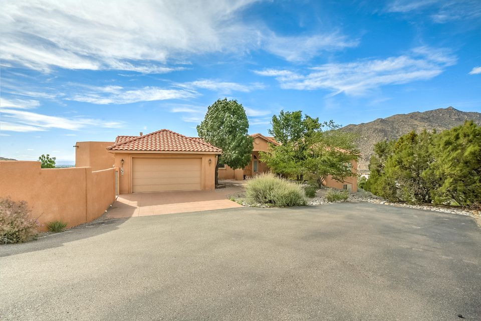 Beautiful property, Great location, Phenomenal Views, tucked away in the foothills. This unique offering has lots of opportunity especially having a full second living area, 1352 sq ft, on lower main level with its own upgraded kitchen, full bath, bedroom, private entrance, garage and driveway. The main floor has a wonderful open floor plan with incredible views, lots of windows & light, large living room & formal dining room. Enjoy granite counter tops in a large eat in kitchen, perfect for a gourmet cook! You can also enjoy a family room/theater room w/movie screen & projector. Master bedroom has a huge master bath w/jetted Ultra tub, 2 way fireplace,large master closet and lots of storage space. Large oversized garage, walk in safe all on a 1.87 acre view lot!