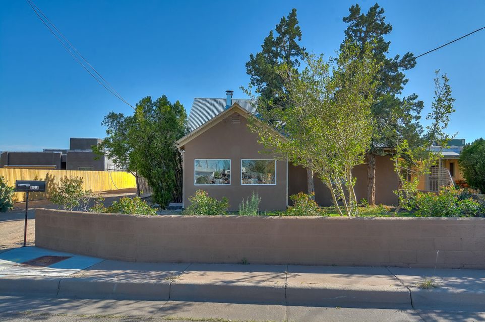 Splendid 1940's Northern New Mexico farm house, completely remodeled, located on a large .33 acres in the North Valley! Home features 2,221 sf with 4 bedrooms, 3 bathrooms and a separate Casita with bath! Beautiful new kitchen with custom ceiling height cabinetry and crown molding, granite countertops, upgraded stainless steel appliances, stone backsplash and recessed lighting. Cozy living area with new hardwood flooring. Gorgeous master with hardwood floors and brand new en-suite. Ensuite hosts a large walk-in shower with custom tile surround and floor, new vanity w/ granite top, stone backsplash and new fixtures. Upstairs loft with custom wet bar. Casita w/ exposed wood beams on the ceiling, kitchenette area and bath. New refrigerated air, new furnace, new hot water heater and windows!