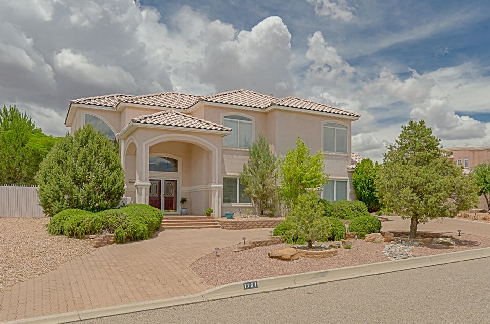 Stunning Custom in Rivers Edge 2, steps from the Bosque, with gorgeous backyard retreat.  Beautifully landscaped w/in ground spa, outdoor kitchen, patios, gazebo..added bonus:  Sandia Views. Original owners have loved this home and it shows! NEW MICRO WAVE & OVEN*NEW CARPET* FRESH PAINT! Light, bright kitchen w/ walk in pantry & gorgeous 3cm granite counters. Gas cooktop in island has retractable fan which ventilates to the outside. Breath taking staircase leads to huge loft, 2 guest rooms + full bath and the master suite.  King sized master w/ 2 way FP, balcony overlooking backyard & walk in closet to die for!  The loft is perfect reading nook or office space.  4th Bdrm or Office is downstairs + full bath. Drvwy laid w/ pavers. Much to appreciate! Motivated SELLERS! COME SEE & WRITE OFFER