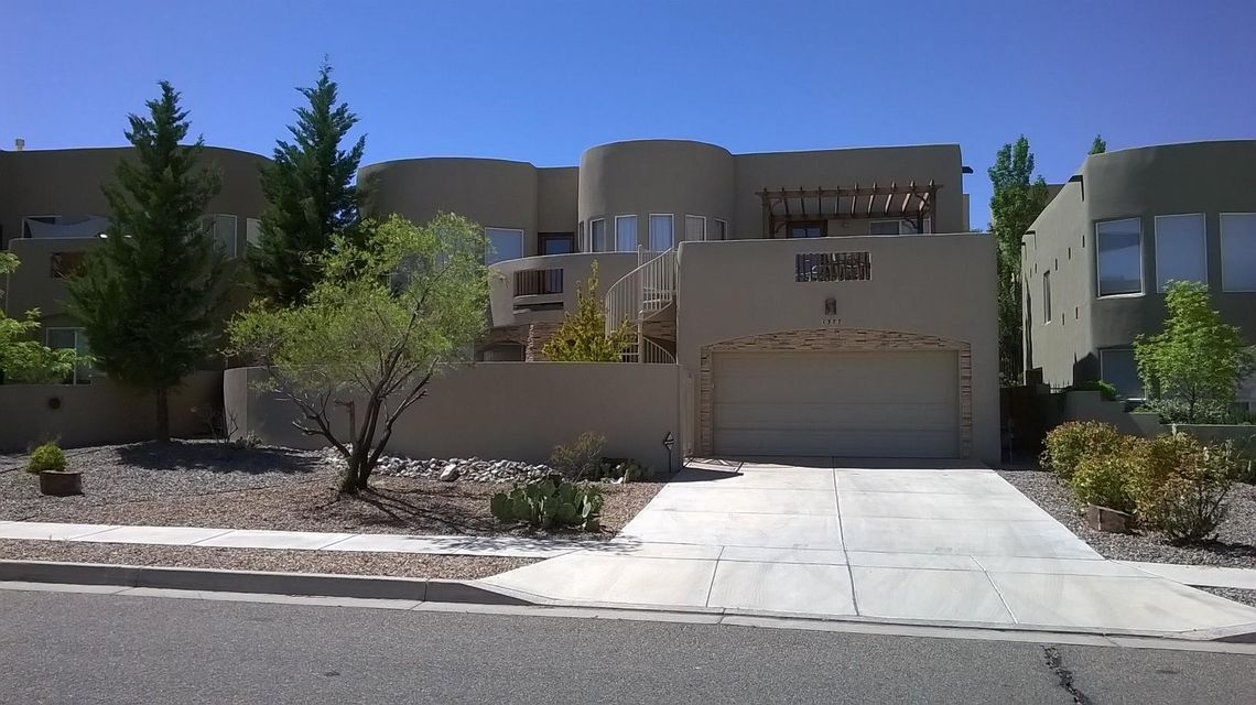 Spacious Custom built home with vaulted great-room ceiling, lots of natural light & gaslog kiva fireplace. Gourmet kitchen with stainless appliances: gas cooktop, double ovens & microwave, granite counters, walkin panry, island & bar. Huge mstr suite w/attached office/gym/nursery and large balcony/deck w/fantastic mountain views. 2 additional bedrooms & loft upstairs. 18'X13' Home Theater. Home has radiant heat, forced air heating & refrigerated air cooling. 6 Hole putting green in backyard & courtyard in front with rock fountain. Private Covered Patios and pre-wired for hot-tub.