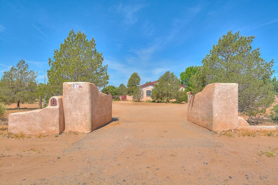 Great investment opportunity! Home is As-Is. Corner lot. Manufactured home updated with pitched roof and extra space. Completely fenced yard with Fruit trees and great views of the Manzano Mountains. Separate guest house with 750 sf.