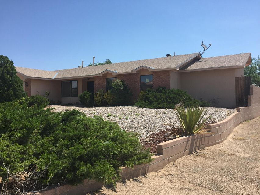 Single level brick home on a corner lot!Double door entry leads you to an office and 2 living areas with bay windows.  Family room features a kiva fireplace. kitchen has a pantry and a breakfast nook and a pass thru to the family room.  Master suite is complete with double sinks, garden tub, large shower and a walk-in closet.