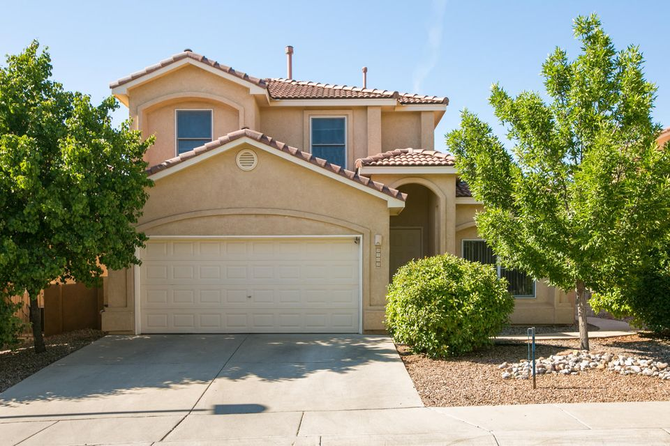 Beautiful 5 bedroom, two story home in gated community inside La Cueva school district, easy access to Paseo Del Norte and shopping amenities in north east heights. Separate laundry room off garage, and wonderful balcony mountain views!