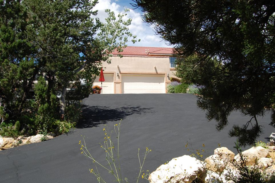 Visibility for 50 miles.  Three of the 4 bedrooms have up-high visibility of the Monte Largo Mountains.  Multi-purpose room has close-up views of the green alpine vegetation of the Sandia Mountains.  Elevated lot. Fifty thousand in remodeling costs in 2014 including updated counter-tops, and plumbing fixtures throughout.  Eight thousand in remodeling costs in 2017 including downstairs bathroom.  Conversion of downstairs area to shower possible.  Large area of lot is fenced.