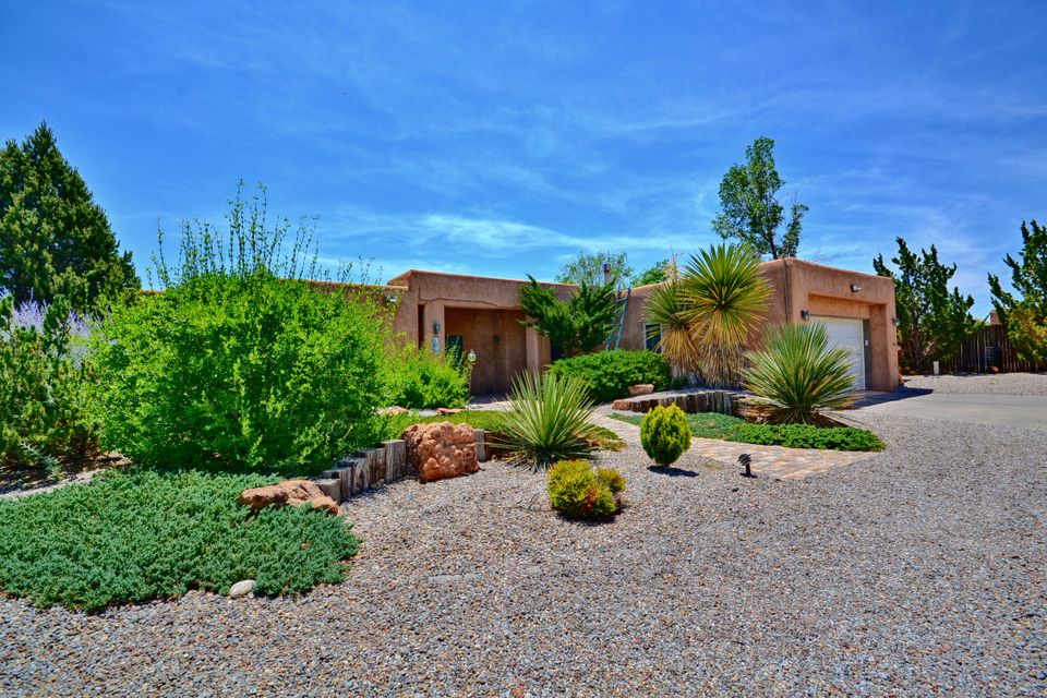 Million-dollar views from this gorgeous custom home. Spacious great room w/ vaulted ceilings, clerestory windows, kiva FP & beautiful mountain views. Sun-filled, updated kitchen w/ granite countertops, custom cabinets, built-in cooktop & breakfast bar. Master retreat w/ walk-in closet & beautifully remodeled master bath with walk-in shower - you must see to truly appreciate. Top-of-the-line, new porcelain tile throughout interior & exterior spaces, new carpet in bedrooms. Baths updated w/ granite and tile surrounds, new fixtures. Solid wood doors. Abundant outdoor living space. Interior courtyard w/ fountain brings light into every room. Private backyard w/ spa area, incl. hot tub, FP & outdoor shower, & patio w/ views of mountains & valley. New well pump & reservoir 2016, new septic 2013