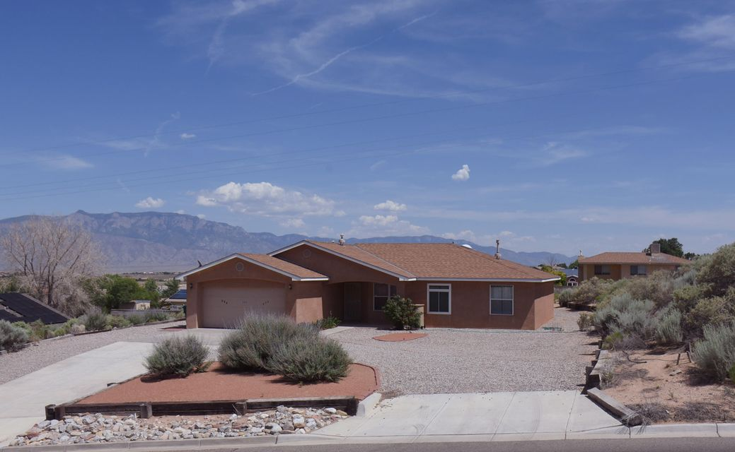 Lovely 3 bedroom home on 1/2 acre lot that has been landscaped with southwest gravel and drought resistant plants. Home has mostly tile flooring with carpet in bedrooms and hall. Carpets were just cleaned and the entire home has fresh paint and is move in ready!  Kitchen has center island and breakfast nook.  The home has 2 living areas and an office/hobby room which could make a 4th bedroom. The views from this charming home are simply breath taking. There is a large storage building that is on a foundation and could double as a work shop. Home also has refrigerated air and hard water softener system and some new windows. Come see this great home! You will not be disappointed.