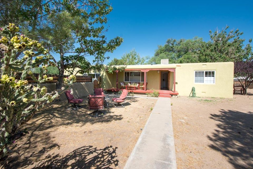 Lovely North Valley charmer situated on a one third acre corner lot with side yard access! This 3 bedroom 2 bathroom home has some beautiful details, variance plaster walls in the living/dining room, master bedroom and an additional bedroom. Newer skylights installed in 2015 bringing in lots of natural light, newer water heater and furnace installed in 2016, and beautiful coyote fencing added to the walled in yard for privacy without obscuring the desired NM views! There is saltillo tile in the sun filled family room, and gleaming wood floors in the living/dining and bedrooms. The front porch has been freshly stained and exterior of the home was just coated with elastomeric stucco (June 2017).