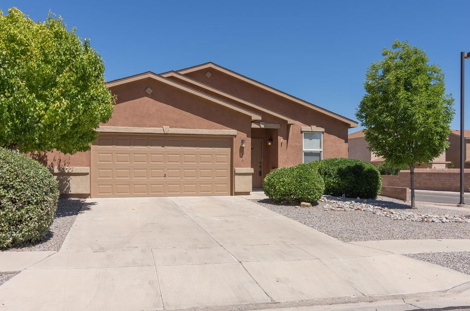 Fantastic single level 4 bedroom, 2 full and one 3/4 bathroom home, located on a generous corner lot with possible backyard access! Step inside and experience an open and spacious floor plan with a separated master suite and separated 4th bedroom, perfect for extended families or ideal for home office. Wonderful great room with a gas log fireplace, cathedral ceilings handsome laminate wood floors. Open kitchen with breakfast bar, pantry, gas stove and spacious dining area with sliding door to the covered patio! Master bedroom offers a walk-in closet and full bathroom with a garden tub, separate shower and double sinks. Oversized 2.5 car finished garage! Wood blinds! Excellent & conveniently located to shopping and short distance to the community park and pool! NICE!