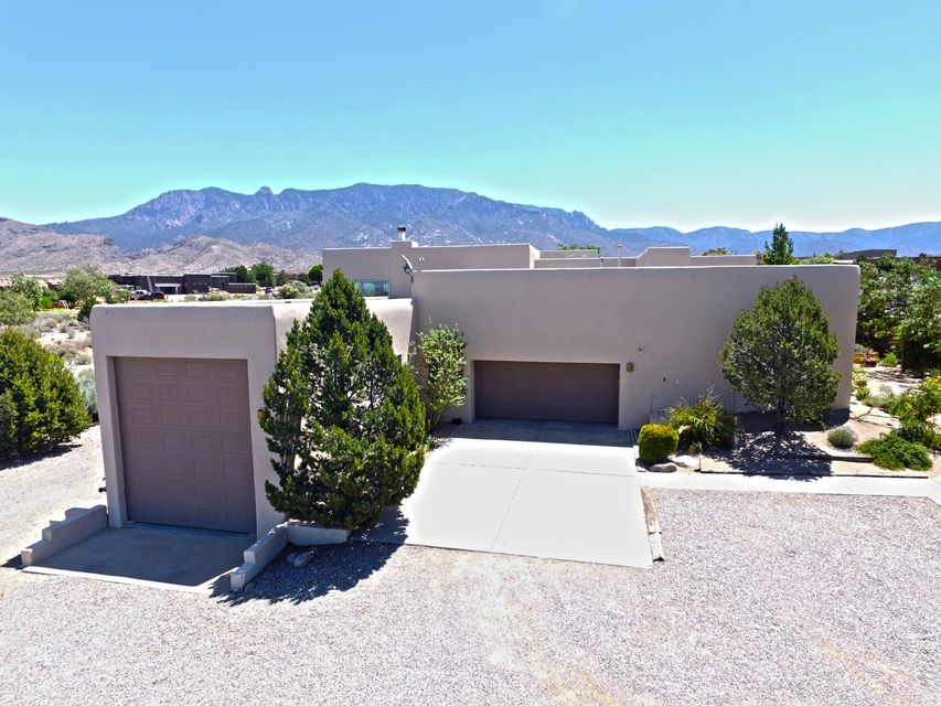 Talk about a dream home! 1.63 acres in Sunset Hills Estates with AMAZING mountain and city views that you have to see for yourself. Over $140K in high-end updates! New tile, carpet, and custom knotty alder doors throughout the WHOLE house. New granite counter tops in master/guest bathrooms. Front/back yard is fully landscaped , including 4 species of fruit trees, grape arbor vines, with auto irrigation. Four possible bedrooms, one that is currently in use as an office.  Brand new stainless steel kitchen appliances, deep double copper sink, and state of the art induction stove. New paint throughout the house, and 2 new Aero Cool Units.  For RV lovers, this property has an oversized RV garage, and access to electrical, water & sewer hook ups for your convenience. Endless Possibilities!