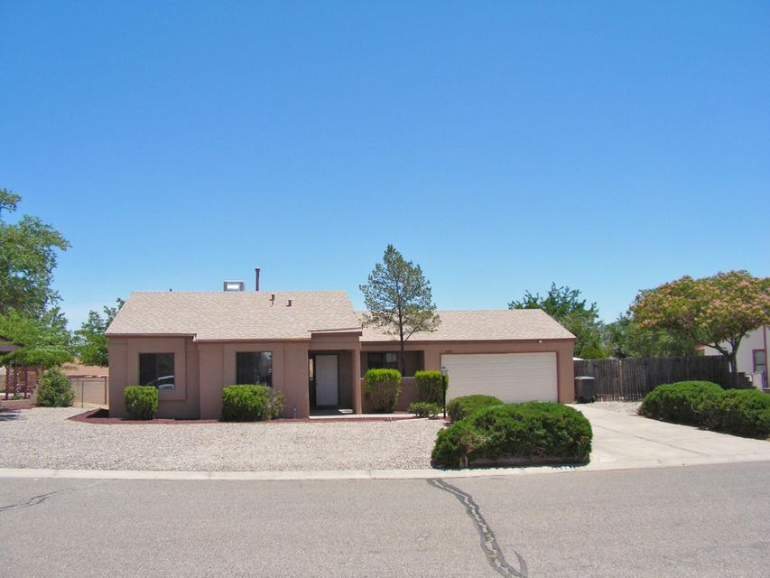 Updated home on large lot with Sandia views. Kitchen has been updated with new cabinets, tile counters, backsplash and new stainless steel appliances. Open to dining and living room. New carpet and ceramic tile, fixtures and both baths have new tile in Showers and vanities. Fresh paint. Living room features fireplace. Master has double closets and private sliding door to big backyard. Covered Patio and move in ready.