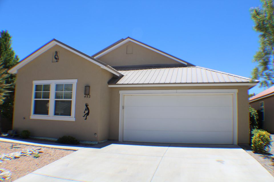 One owner home shows pride of ownership. Many upgrades at time of purchase. Absolutely amazing backyard with water fall and goldfish pond. Master bedroom separate from other bedrooms on other side of the house has big bathroom with separate shower, garden tub,double sinks, & huge walk in closet. Ceiling fans & is wired for stereo. Covered entry, covered & open patio areas. Attic has pull down stairs & is decked. Air conditioner about 5 years old. Park is close by as is shopping.