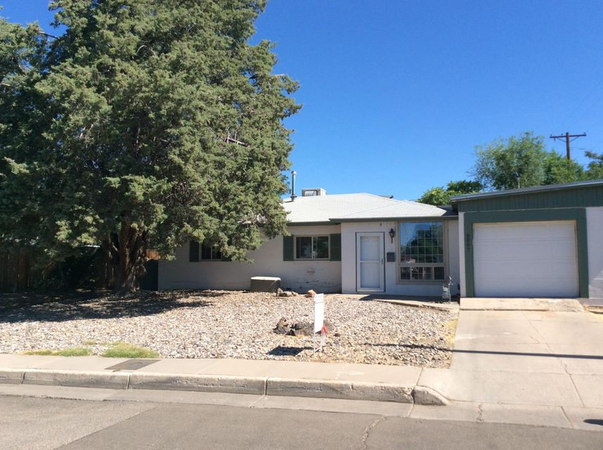 SANDIA High School School District. This well maintained home has plenty of room for a new owner. There is newer laminate flooring in living areas, and formal dining room, ceiling fans throughout the home along with a beautiful backyard to entertain in. The home is conveniently located one block from Hoffman Park that has tennis courts and a play area for children. You are also minutes away from ABQ Uptown and Coronado mall. Call for your private showing today.