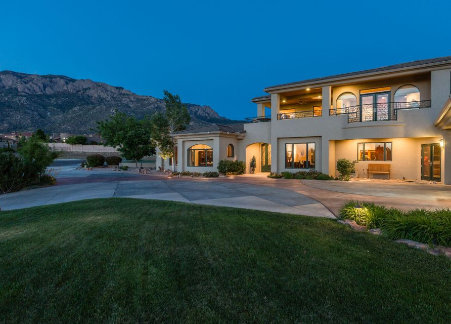 If you are looking for a gorgeous custom home with a spacious, multi-use floor plan, jaw-dropping mountain and city views... and the perfect backyard haven for entertaininglook no further!  This contemporary gem includes a master suite with views on the first floor accentuated by a luxurious bath with an enormous, custom curved glass shower; a chef's kitchen with top of the line appliances; 5 possible bedrooms; multiple living/entertaining areas upstairs and downstairs; a large, covered balcony with stunning views of Sandia Mountain, sunset and city lights; a private, park-like backyard with a heated, in-ground covered pool with uv sanitation, and a massive, 9 car heated and cooled garage and work shop space.  Bring your clients and make an offer today.