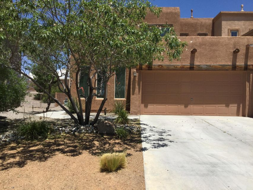 Simply Amazing Town Home in a Lovely Gated Community with Walking Trails and Parks!  Fabulous Floor Plan has Two Separated Master Bedrooms and Two Living Areas!  Granite Kitchen Counters, Under Mount Kitchen Sink, Light Filled Dining Room with View of Park Across the Street!  Upstairs Den has Gas Log Fireplace and Built In Bookshelves, Views from Upstairs Bedroom and Den!  Enter Upstairs Master Bedroom through Double Doors, Built In Bookshelves, Huge Walk in Closet with Windows!! Private Landscaped Backyard on a Premium Lot!  Walking Distance to Cabezon Park and Community Pool! Very close proximity to Rust Medical Center!  Move In Ready!!!
