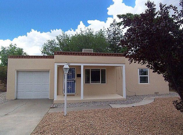Wonderful north UNM location just minutes from UNM Main and UNM Law, easy walk to Summit Park and easy access to Nob Hill, Downtown, and the Big I freeway access! Freshly painted with many updates throughout including Prairie style thermal windows, tile floors in Kitchen & spacious (24x12) Family room, a new roof in 2011 and updated Kitchen with ample cabinet space and stainless steel gas range. Hard wood floors in front living area, bedrooms and study. 3 Bedrooms or 2 Bedrooms with a study/office. Lots of built in storage. 1 car attached garage and separate laundry room. Large 1/5 acre lot with mature shade trees & private back yard. Short walk to Montezuma Elementary School. Conveniently located near Whole Foods, shopping, dining & entertainment!