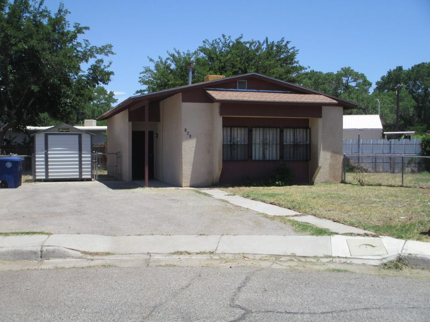 Great starter home in South Valley. 2 Bedrooms and 1 bath. Near Tingley park, Rio Grande river, Aquarium, Bio Park and ARTransit Newer CFA furnace and water heater. Newer cabinets, gas stove, inside washer hook up and double closets in one bedroom. Pitched roof & evap. cooler. House gets plenty of natural light. Fridge and Morgan storage building stay. Plenty of off street parking. Wrought iron screen doors and window bars. Easy to maintain fenced yard.