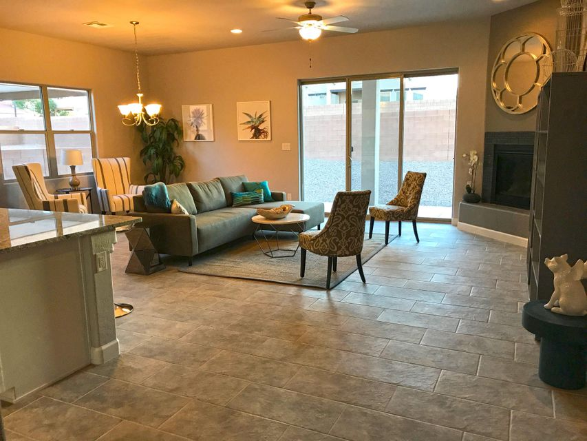 This treasure has countless amenities.You will fall in love with the great room with beautiful light from huge sliding doors to covered patio. It has high ceilings!The kitchen has a huge island, with beautiful granite counter tops a farm sink, Bosch Appliances, Gas Range and separate oven/microwave. The open dining, kitchen and living includes a gas fireplace. The beautiful master is downstairs and it has a bedroom/office downstairs as well. There is a powder room on the main level, also. Upstairs has 2 large bedrooms and a fabulous, huge loft with a veranda facing the Sandias! Twilight Features also include in wall extermination system, tankless H2o heater, superior construction with a 2 years warranty and 10 year warranty on structural. Also it's a Gated Subdivision.