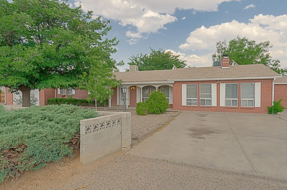 Sprawling ranch on 1/2 acre in Rio Rancho! Home features private entrance to an office and back yard access, making it perfect for the small business owner! Great room with wood tile and wood burning fireplace, spacious kitchen with raised panel oak cabinets, solid surface counter tops, large dining area off kitchen with bay window.  Master suite has double sinks and shower.  This home features in home office or possible 4th bedroom, tons of storage space, covered patio and rear yard access.