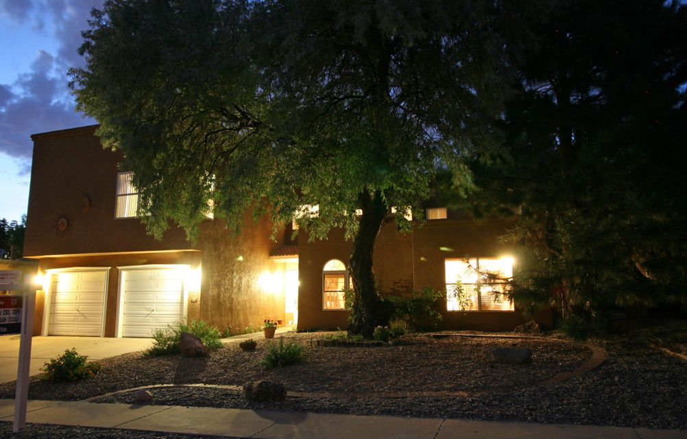Group OPEN House Sun,7-9-17.1:00-3:00. AMAZING Heritage East home.Loaded! Originally a builder's residence. Sunny kitchen w/ island, flows into the great room w/ vaulted ceilings, clerestory windows, & a 2 sided stack stone fireplace! Tons of kitchen cupboards, granite counter tops, stainless steel appliances & a generous pantry. Formal dining room & two masters! 2nd master is big enough to share! Bedroom/office & a full bath on the main floor, (possible in-law wing.) Luxurious master bedroom & bath offers a jetted soaking tub, his & hers sinks & a walk-in closet. All bedrooms are huge! Wood, tile & carpeted floors. REFRIGERATED AIR! Amazing backyard w/ a deck. Perfect home for entertaining! Pergola patio cover & mature shade trees.  Stop by and check it out. You won't want to leave