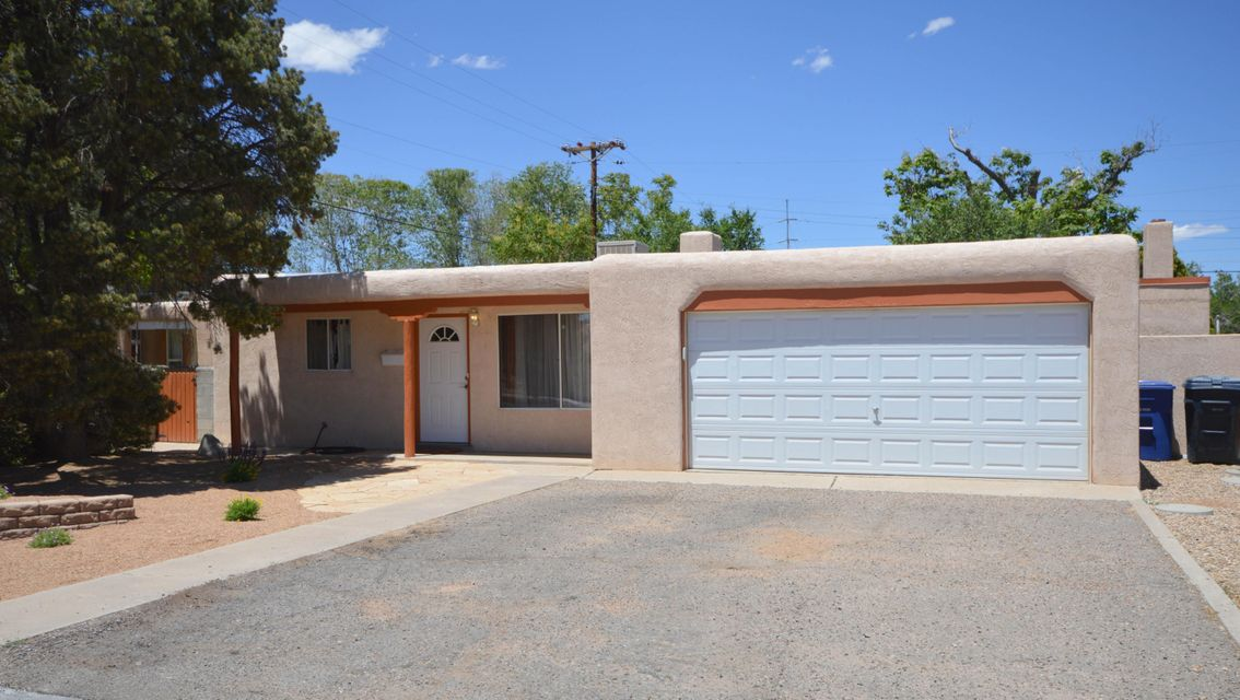 his lovely home has two large living areas both with wood burning fireplaces. Kitchen has maple cabinets, builtin microwave and large formal dining area. Home has three spacious bedrooms including master with beautiful bath update. Yard has low maintanance landscaping with covered backyard patio. Great Uptown location with quick access to shopping dining and freeway.