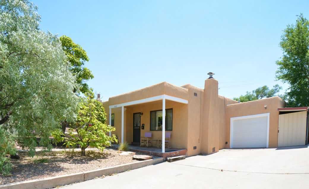 Clean Move-in Ready UNM AREA home with a BRAND NEW (June 2017) Heating / Refrigerated air combo unit for those hot Albuquerque summer days. 3 bedrooms, 1.75 baths, a family room, plus an extra long attached garage. Open floor plan with carved wooden beamed archway between kitchen and living room. Wood burning fireplace insert with glass doors in Living room. Sola-tube skylight in spacious kitchen. Hardwood, cork, and ceramic tile floors through-out. NO carpet. Generous closet space in each bedroom.   Ceiling fans in all bedrooms. Lush private backyard with storage shed complete with electricity. All major appliances convey with home. Extra deep driveway for those extra cars. Close to the sports stadium, Puerta del Sol Golf Course, and bus lines.