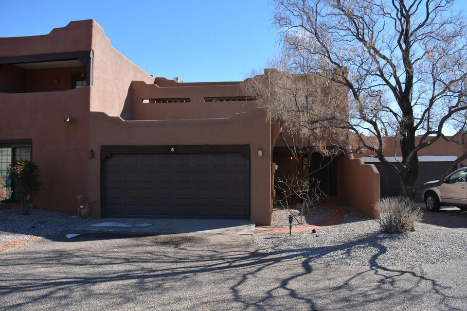 Beautiful Townhouse in Pueblo Los Cerros Community. Shared Clubhouse for family events, swimming pool and tennis courts. Home has kiva fireplace, beautiful views from back yard and upstairs balcony.