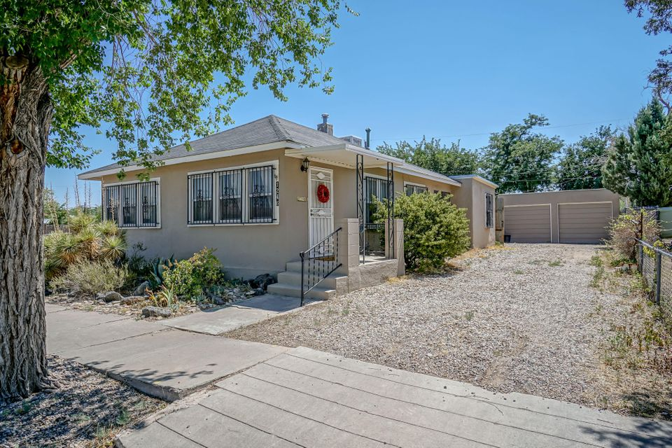 Come see this super cute east Old Town Bungalow! Great location to be near local restaurants, Old Town, and the bustling Sawmill District. This home has fabulous architectural features, and it\\\'s oriented so you can use it a multitude of ways! A perfect 2 bedroom home with two living areas and 3 bathrooms or 2 bedrooms plus office and one large living room; or the home has a doorway to close off the back half of home to be a private residence, the front becomes a short stay vacation or visitor rental. Enjoy the stunning hardwood floors, the newer roof and other upgrades, plus a 2 car garage, and a private backyard with Latilla covered patio with mountain views. Floorplan available. Many upgrades have been made to this home!