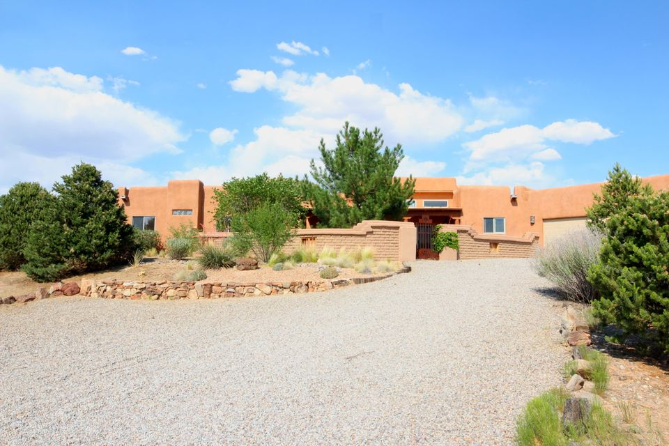 Custom Pueblo Style Home located in Beautiful Sundance Mesa Subdivision of Placitas. NM. Enter the home through an Inviting Courtyard, featuringCorbels, Latillas, & Vigas. This house has an Open Floorplan. A Kitchen w/Walk-in Pantry, Wet Bar in Great Room with Kiva Fireplace. The Master BR leads to a Master Bath w/Jetted Tub, Snail Shower,and an Oversized Walk-in Closet. Back Patio has a Custom Fireplace. The Patio Spiral Staircase leads to the Rooftop with Breathtaking 180 Degree Views of the Wonderful Western New Mexico Skylines.