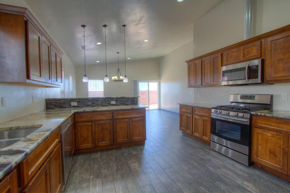 This Home is Exquisite! Beautiful High-End Contemporary Feel. Gorgeous Level 5 Granite, stainless steel appliances. Open floor plan. Large Bedrooms, Refrigerated Air! Xeriscape Landscaping. Full Alarm System and Cameras. Don't miss this opportunity.