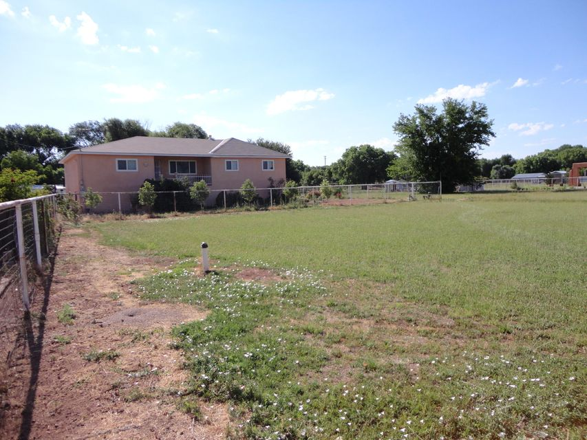 Acreage,Horses,Farming,irrigation. This wonderful 4BR home situated on 2.20 acres.Comes with metal horse stalls with enclosed tack room.Pipe fencing throughout. Separate pasture areas.Home has an nice open floor plan: Huge master living area,upgraded laninate flooring,wood stove,New Deck in Back.New Stucco,New Windows,New Furnace,New Roof.Come and enjoy rural living, bring your horses and start enjoying today