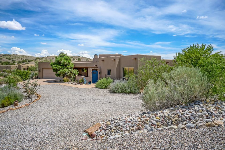 Welcome to 1 Seasons Circle! This stunning retreat pairs Southwest architecture paired with modern construction and amenities. You are greeted by a tranquil courtyard with incredible views. Inside niches, beams and custom touches abound. A massive living room with Kiva fireplace spills onto spacious covered patios. Stainless steel kitchen. Relax in the master retreat, with ample closet space and soaking tub. Oh did we mention the private master bedroom patio and courtyard. 2 more bedrooms boast walk in closets and share a bath. Over-sized 2 car garage. Enjoy the best Placitas has to offer. Conveniently located in Sundance Mesa. Inspection on file, repairs are done.