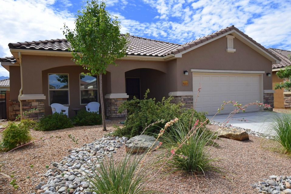 Stunning 3 bedroom 3 full bath home in New Mexico's premier 55 + active adult community by Del Webb.  Meticulously cared for by non-smoking owner with no pets.  Upgraded tile in main living areas.  Carpet in bedrooms only.  Gourmet kitchen with staggered cabinets, granite counters, stainless steel appliances, pull out drawers in lower cabinets, cabinet hardware, gas cooktop and walk-in pantry.  Master bathroom suite boasts double sinks, corner tiled soaking tub, oversized walk-in shower with tile surround and bench.  Skylights, textured walls, ceiling fans and fabric Bali shades throughout. Private and fully fenced backyard with oversized covered patio and gas stub for BBQ.  Lovely gated community with clubhouse, indoor/outdoor pools, fitness center and more!  Move right in and enjoy!