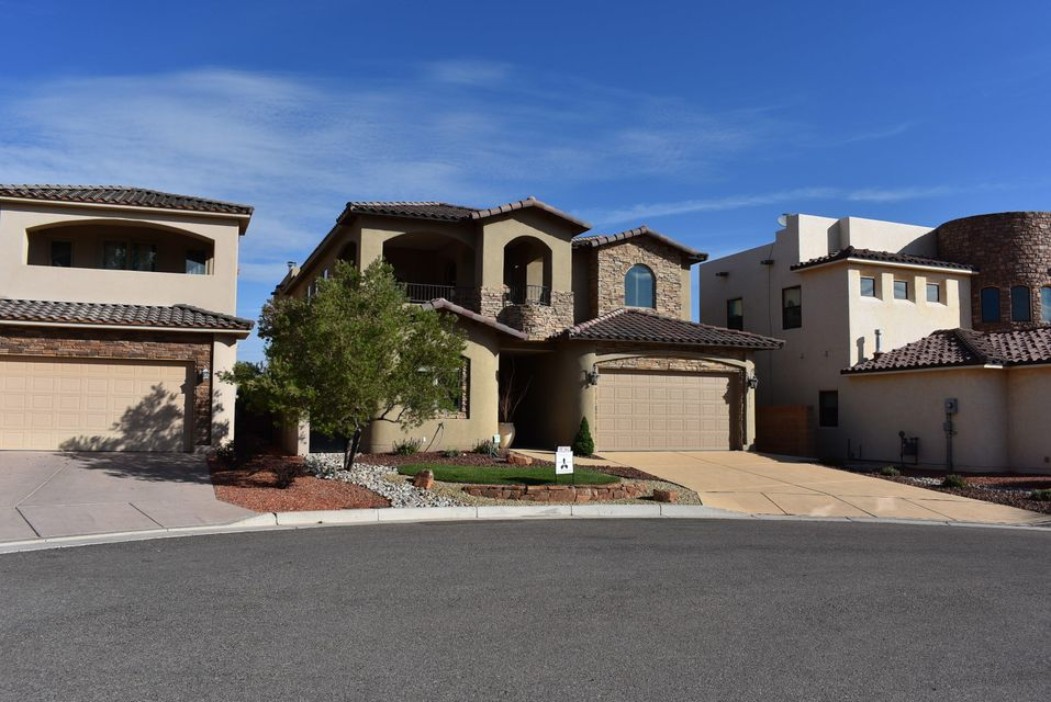 Luxurious Tuscan style home with many high end features and captivating views. Diamond finish plaster, alder wood cabinets, travertine floors, wood floors, lush upgraded carpet in the owner suite, water softner & reverse osmosis, chef's kitchen with granite counters & stainless appliances, 21'+- foot living room ceilings, Pella windows, Hunter Douglas window coverings, surround sound, radiant heat & refrigerated air (two AC units). Spacious owner suite with two decks, its own 28 x 18 living area and wet bar take up the entire second floor. Suite includes separate shower & jet tub, large walk-in closet with mountain views (From closet & east deck). Easy to maintain landscaped yard. Washer, dryer & refrigerator negotiable. This home has been impeccably taken care of-it's spotless.