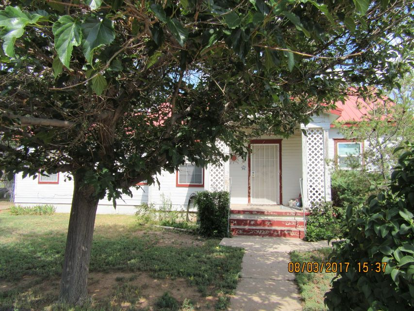 Sweet little home just like Grandma's.This home was moved to the lot over 50 years ago.  Original wood floors in living room and under carpet. Lovely back yard, fenced. Great home with lots of personality.  Take a look Original hard wood doors.