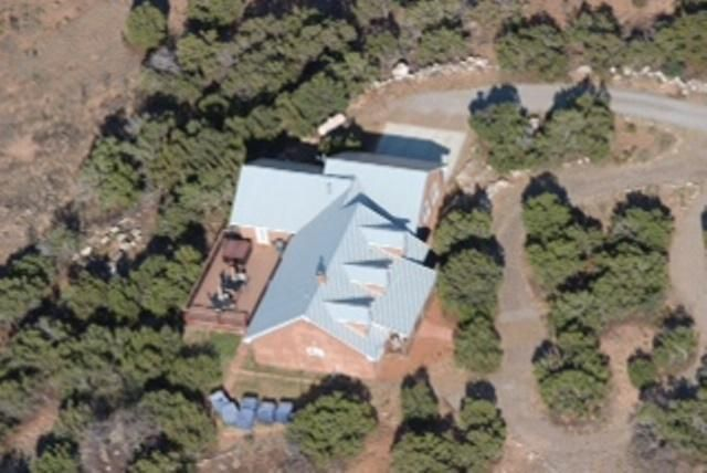 Two houses on 120 fenced acres only 22 miles south of Tijeras, just a short drive to Albuquerque. Bring your horses, cattle, goats, llamas, what have you, or just enjoy the privacy and tranquility among the pinons and junipers. 2200 sq ft main house sits atop a ridge, providing beautiful views in all directions. Cathedral ceilings throughout. 2-FP, open floor plan. Roomy master suite with custom walk-in closet. Over-sized, attached garage. he 900 sq ft bonus house features 2 bedrooms, full bath, living room w/ WB-FP, kitchen with range & refrigerator. This house would make ideal quarters for in-laws, guests, older children, long-term rental or Airbnb. Owner will consider REC with substantial down. Take the scenic drive to this beautiful property- you will not be disappointed.