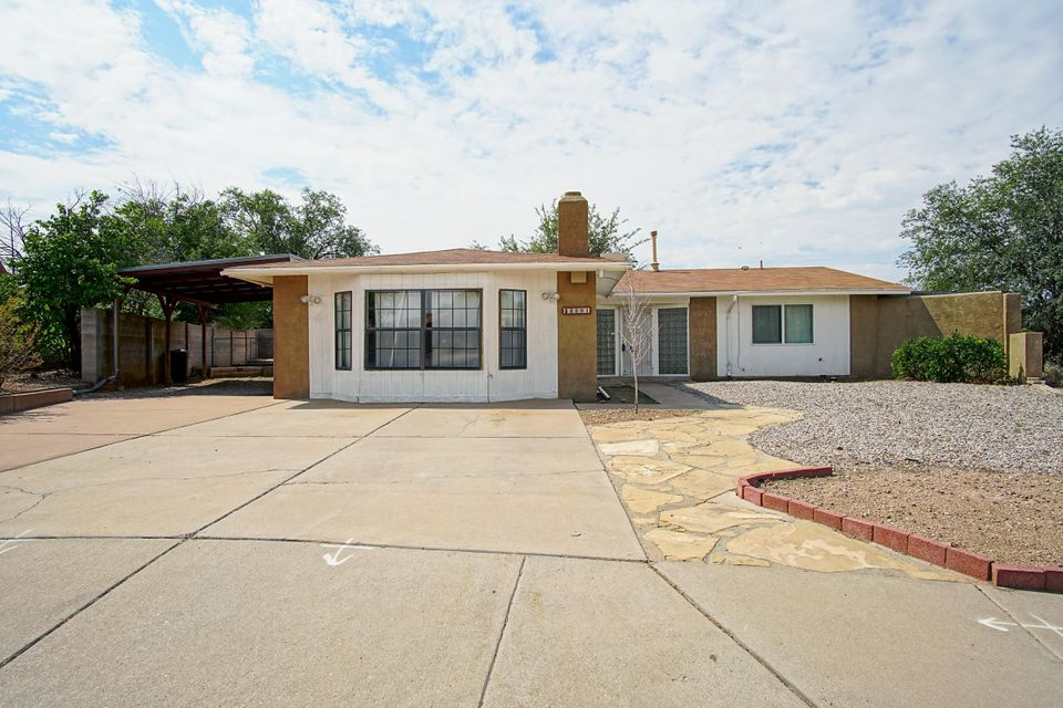Great Location!This lovely home is located in the desireable NE Heights minutes from the Balloon Fiesta Park and minutes from I-25. This NE gem of a home is located in a quite neighborhood at the end of a cul-de-sac that features 4 Bedrooms, 2 Bathrooms, 2 wood burning fireplaces that you can enjoy in the living area or simply while in the largest bedroom that has a Kiva fireplace while you relax in bed. Home comes with a large covered patio, 2-car covered carport, spacious backyard and storage for extra space.