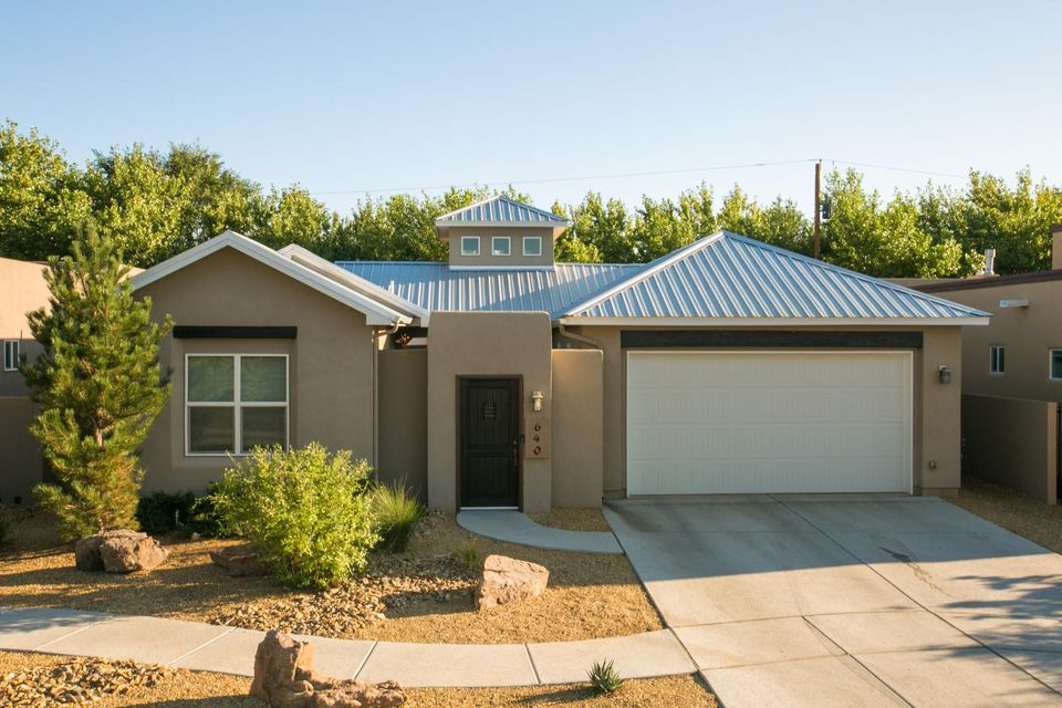Old Town, North Valley, Downtown and Sawmill District. Enjoy this historic area filled with lush greenery and mature trees, all tied in with a modern twist.  This newer built Home (2012) is in the heart of Albuquerque, tucked inside a private Gated Community.  Enjoy Luxury Finishes with Granite Counters, Engineered Wood Floors, Pella Windows, Tankless Water Heater, Refrigerated Air, Energy Efficient Furnace with Air Purifier System and Gas Log Fireplaces.  The Dream Kitchen has a Jen-Air Appliance Package to include a Refrigerator, Gas Range Cook Top, Dishwasher, Stand Alone Vent Hood, Wine Cooler and Double Ovens.  After dinner, enjoy dessert as you cozy up near 1 of 3 Beautiful Gas Fireplaces.  Did I mention this Home is NM Green Build Silver Certified? $ave BIG money on Gas & Electric!!