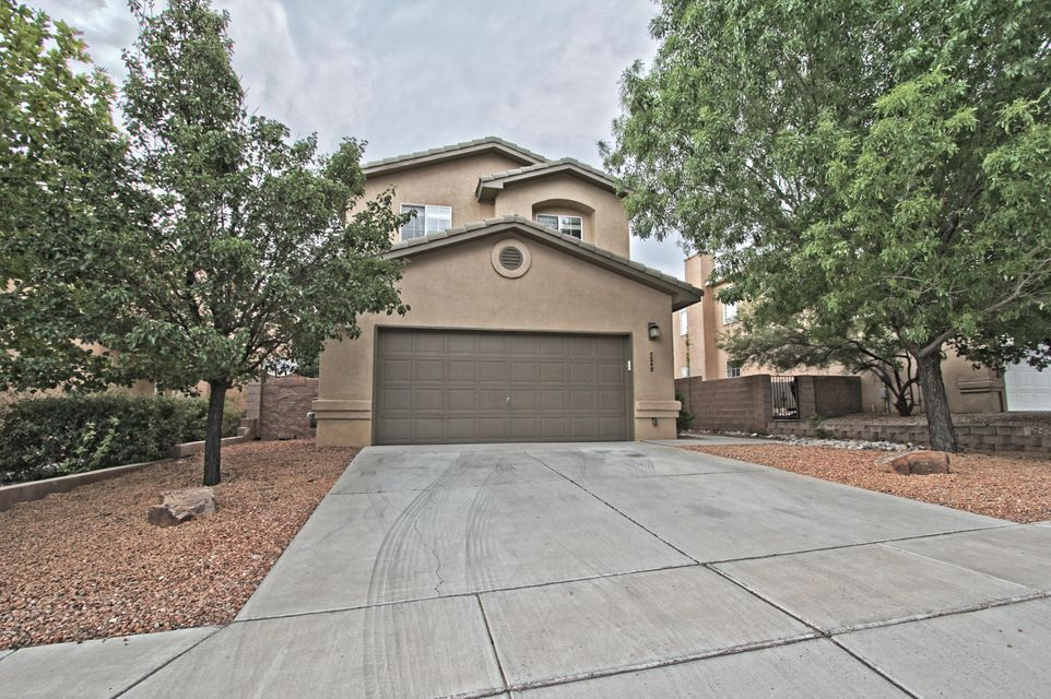 Welcome to this beautiful home located in the  desirable neighborhood of Desert Ridge Trails!  Presenting a large open floor plan with two living spaces on the main floor, the property features a large kitchen with a breakfast bar, gas fireplace, refrigerated air, recessed lighting, upgraded light fixtures, NEW carpeting, NEW two-toned paint, sound proofed insulation, and oversized finished garage with Epoxy flooring.  Additionally, at the time of construction, the loft was extended to offer a larger living space and can easily be converted to a FIFTH BEDROOM.  The relaxing outdoor environment offers a tranquil Redwood Pergola Patio with stained and etched design concrete complimented with low maintenance custom landscaping.  Be sure to  visit the neighborhood park just a block away!