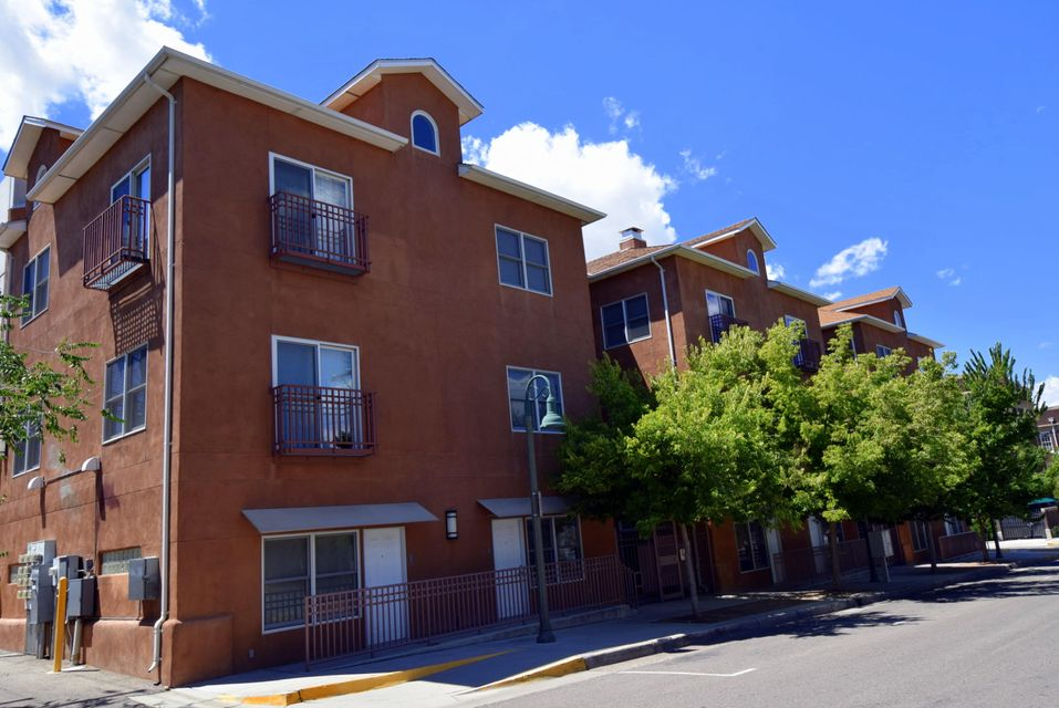 Your chance to own an updated loft in EDO (East Downtown) on a gracious tree-lined street!This bright contemporary loft is centrally located near the heart of downtown ABQ & just a block from the new ART and UNM's Innovate ABQ coming in!Lots of windows,French balcony,vaulted ceilings,wood floors,custom kitchen, spacious pantry,stainless steel appliances,sleek Italian cabinetry & distinctive lighting.Master bedroom boasts a custom walk-in closet & the well-appointed second bedroom closet has added storage atop! This cozy loft with access to the Historic Campus courtyard & covered city parking garage, if desired, is a mile from UNM, CNM,close to Alvarado train station,Cinema 14,within walking distance of top restaurants.Don't miss this penthouse light-and-bright top unit with fabulous views!