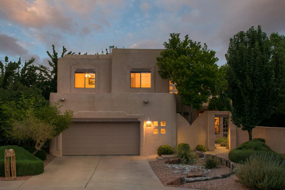 Nestled into the back of a cul de sac in the North Valley community of The Meadows,this lovely Pueblo style home built by SunnQuality boasts 2,800 square feet with 4 bedrooms and 3 baths.You will be greeted by a charming entry courtyard that wraps around to the backyard, great for entertaining.The home has a great floorpan with TONS of light, lots of windows and skylights, tile floors and a wonderful enclosed sunroom. The upstairs masterhas a spacious balcony perfect for morning coffee and listening to the birds sing. Home is next to the community park, with new stucco and a newer membrane roof.A great location close to the Co-Op for shopping & convenient to freeways & Downtown,a quick drive to Albuquerque Country Club & it is a quick walk to the Bosque trails. Don't miss the VIRTUAL tour!