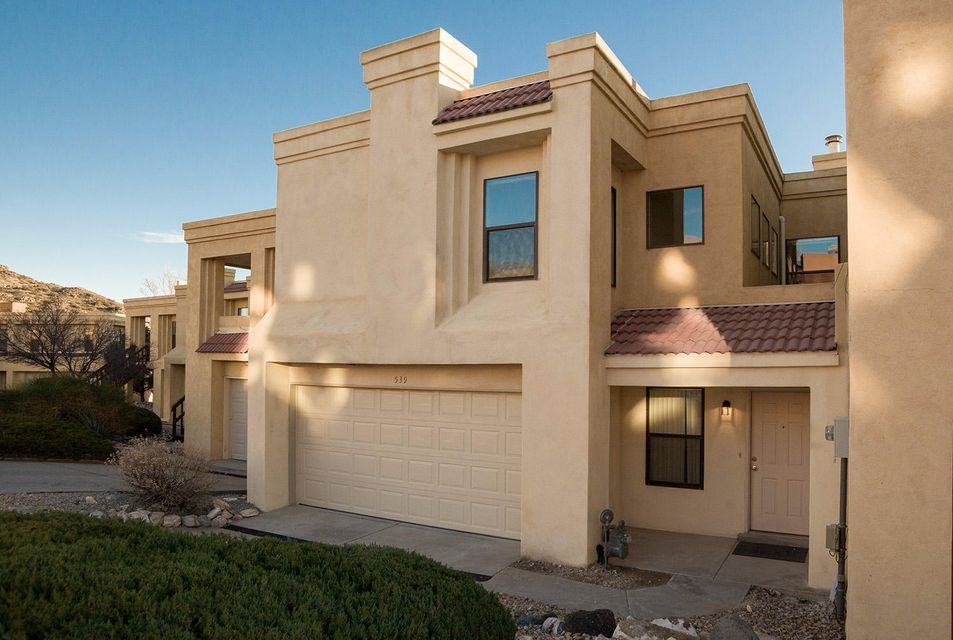 Enjoy the outdoors? Spacious townhome on a quiet cul-de-sac only minutes from Sandia Peak Tramway & hiking trails. Relax on your deck downstairs or balcony upstairs & enjoy views of the canyon, mountain & city lights.  Open floor plan w/lots of natural light.  Features two master suites, clerestory windows, fireplace, skylights, built-in shelving, new carpet and new paint. Living area with separate entrance on first floor could be a guest suite, Airbnb, game room, office, or 4th bedroom--you decide!  No yard, so no yard work! No neighbors in back.  HOA covers water bill.  Convenient to Sandia Labs & I-40.  Schedule a tour today!