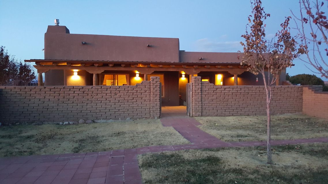 Looking for a cozy home with a spacious lot, lovely outdoor living spaces, and a shop/casita? This could be your Dream home! Perfect for hobbyist, artist...name it, this lovely 1623 sq ft home offers a perfect distance (10.3 miles from I-25) from the hustle & bustle, stunning NM blue skies, amber sunsets over the desert, gorgeous starlit nights, plenty of elbow room, privacy, and comes with an additional 845 sqft heated & cooled detached building equipped with electrical, sink/commode & plumbed for a shower, stained concrete flooring in back rooms, and ready for art studio, storage or maybe a guest house! Other amenities and improvements include; upgraded electrical, stucco/adobe wall enclosing backyard, new gates, rain gutters, newer appliances, flooring, updated window coverings & more!
