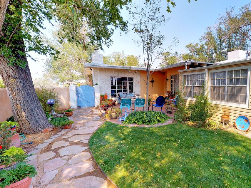 This classic home is sure to capture the imagination. Room to roam on massive lot in the heart of the city! 3 bed 3 bath with basement area. Thoughtful touches include fireplaces and beamed ceilings. Large, verdant yard with romantic gardens. Soothing ponds, comfortable patios and outdoor grill.  Ample off street parking and garages. Enjoy the 3D Walkthrough of your new private paradise.