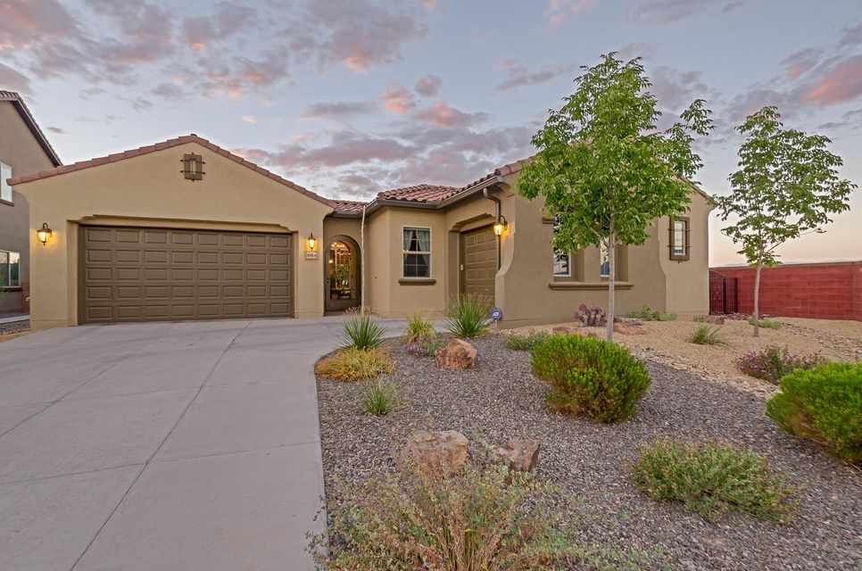This enchanting oasis is located in a prestigious gated community within Loma Colorado. Enjoy fabulous views of the Sandias, valley & city lights. Home sits at the end of a quiet cul-de-sac.  Let the gentle splash of the fountain in the courtyard relax you. Upscale amenities include ceramic tile throughout, custom light fixtures, French doors and Hunter Douglas custom shades. Kitchen with granite island, stainless steel appliance upgrade and custom chef's pantry which includes shelving and drawers for organizing.  Relax in your master suite, enjoying the views from your large windows. Master closet with more custom shelving. Enjoy outdoor living in the park-like yard with views. Close to Rio Rancho high, hospital, theater, shopping, easy access to Albuquerque & Santa Fe.
